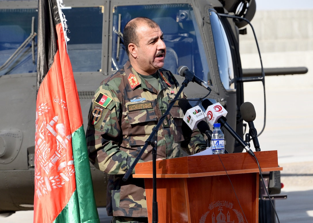 Afghan Air Force Maj. Gen. Abdul Raziq Sherzai, Kandahar Air Wing commander, addresses the first AAF UH-60 Black Hawk pilots during an Aircraft Qualification Training graduation ceremony at Kandahar Airfield, Afghanistan, Nov. 20, 2017. The six pilots are the first to transition from the Mi-17 Hip, as part of a lager modernization program. The AAF is expecting to have four qualified crews by fighting season 2018, and 32 crews by fighting season 2019.  (U.S. Air Force photo by Tech. Sgt. Veronica Pierce)