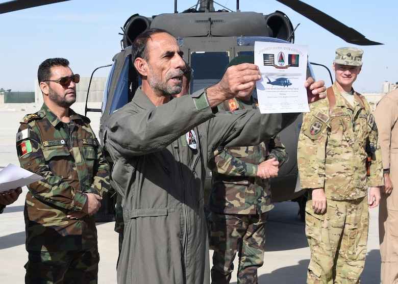 An Afghan Air Force pilot receives a certificate during a UH-60 Black Hawk Aircraft Qualification Training graduation ceremony at Kandahar Airfield, Afghanistan, Nov. 20, 2017. The pilot is one of six to be the first AAF Black Hawk pilots. The first AAF Black Hawk pilots are experienced aviators coming from a Mi-17 background. For future Black Hawk pilots the UH-60 flight training is approximately 16 weeks long, six weeks for Aircraft Qualification Training (AQT) and 10 weeks for Mission Qualification Training (MQT).  (U.S. Air Force photo by Tech. Sgt. Veronica Pierce)