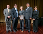 Recipients hold award