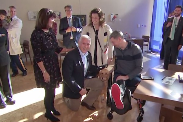 Vice President Mike Pence and Second Lady Karen Pence stand next to a man in a wheelchair.