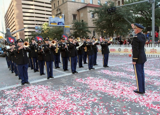 """The 323rd Army Band """"Fort Sam's Own"""" spent Thanksgiving Day morning Nov. 23 marching in the 68th Annual Houston Thanksgiving Day Parade. Thousands of people braved chilly temperatures to line the city streets for the parade. The 323rd Army Band played the National Anthem during the opening ceremonies, then marched off after playing the Army Song."""