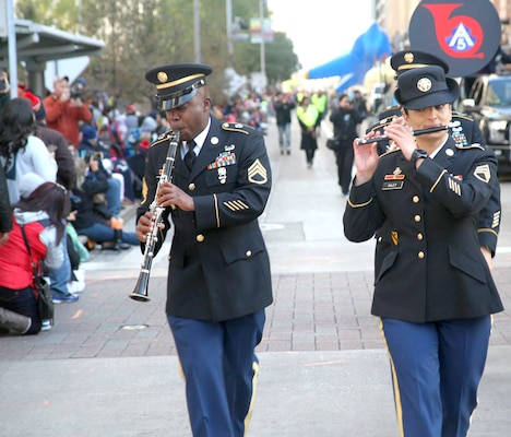 """Members of the 323rd Army Band """"Fort Sam's Own"""" entertain the crowd Thanksgiving Day morning Nov. 23 while  marching in the 68th Annual Houston Thanksgiving Day Parade."""