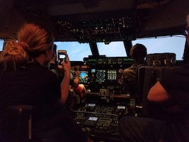Civic Leader, Britni Ridolfi, Captures her experience on her cell phone of flying in a C-5M Super Galaxy Simulator, Nov. 18, 2017, during a 433rd Operations' Group on Joint Base San Antonio, Texas. (U.S. Air Force photo by Minnie Jones