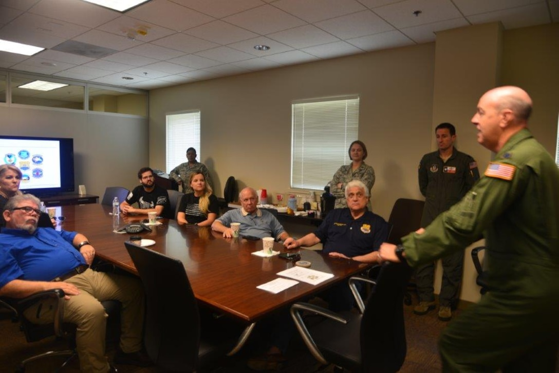 Lt. Col. James C. Miller, 433rd Operations Group Commander, JBSA-Lackland, Texas gives a mission brief to a group of Honorary Commanders and San Antonio's civic leaders, Nov. 18, 2017, during an Operations' Group tour before experiencing flight in a C-5M Super Galaxy Simulator. (U.S. Air Force photo by Minnie Jones)