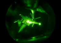 A Republic of Korea Air Force F-15 Eagle maneuvers toward a 909th Air Refueling Squadron KC-135 Stratotanker during a refueling exercise Sept. 12, 2016, over the Pacific Ocean. The 909th and ROKAF trained together to enhance nighttime, long-distance flying capability. (U.S. Air Force photo by Senior Airman Peter Reft)