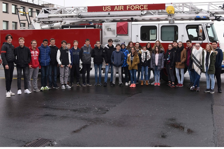 Students from the College de Brumath, Brumath France, pose for a photo outside the 86th Civil Engineer Squadron's Fire Department, on Ramstein Air Base, Germany on Nov. 17, 2017. The students traveled two hours from France to get a tour of the base.
