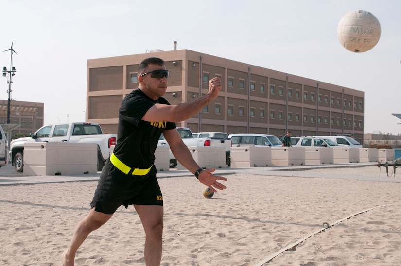 Soldier serving a volleyball.