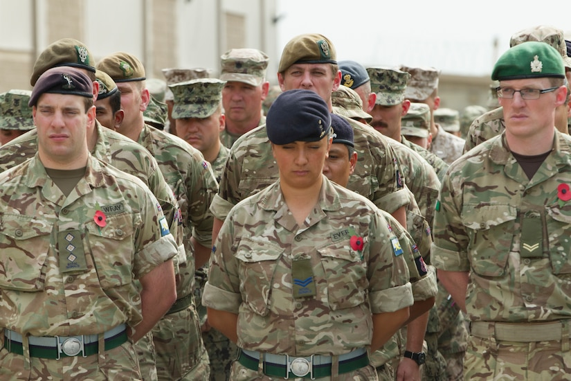 British Soldiers stand at attention during a ceremony.