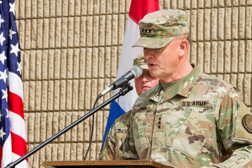 Army General gives a speech at a podium.