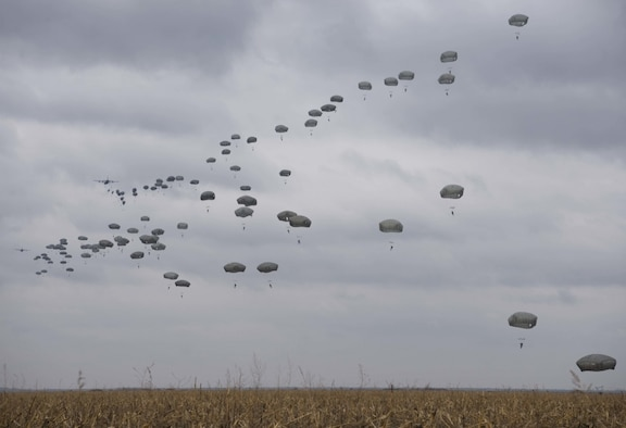 U.S. and Serbian paratroopers descend from the sky during Exercise Double Eagle 2017 in Kovin, Serbia on November 16, 2017. Exercise Double Eagle is a bi-lateral airborne insertion exercise designed to allow U.S. and Serbian forces to work together in areas of mutual interest in securing regional security and peace. (U.S. Air Force photo by Senior Airman Elizabeth Baker)