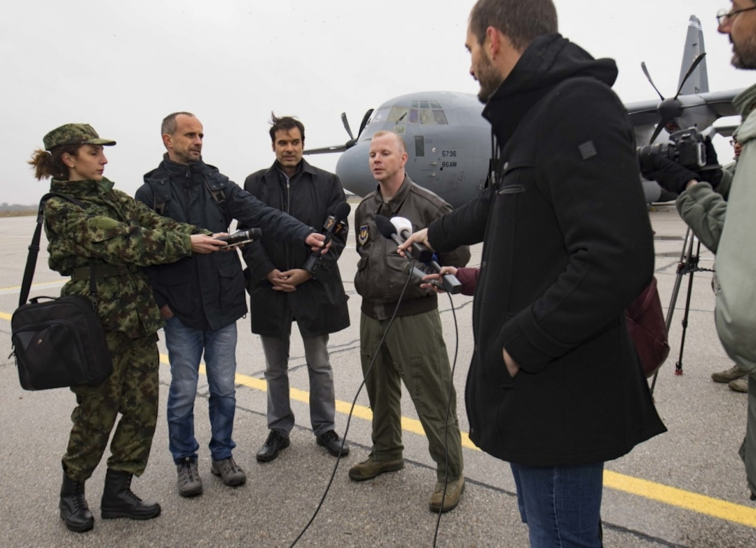 Serbian media representatives interview Maj. Jared Sorensen, 37th Airlift Squadron C-130J Super Hercules pilot, on Batajnica Airfield, Serbia, Nov. 14, 2017. Interviews and guided tours through a 37th AS C-130J kicked off Exercise Double Eagle, a bi-lateral airborne insertion exercise designed to improve emergency rapid-response and strengthen regional security. (U.S. Air Force photo by Senior Airman Elizabeth Baker)