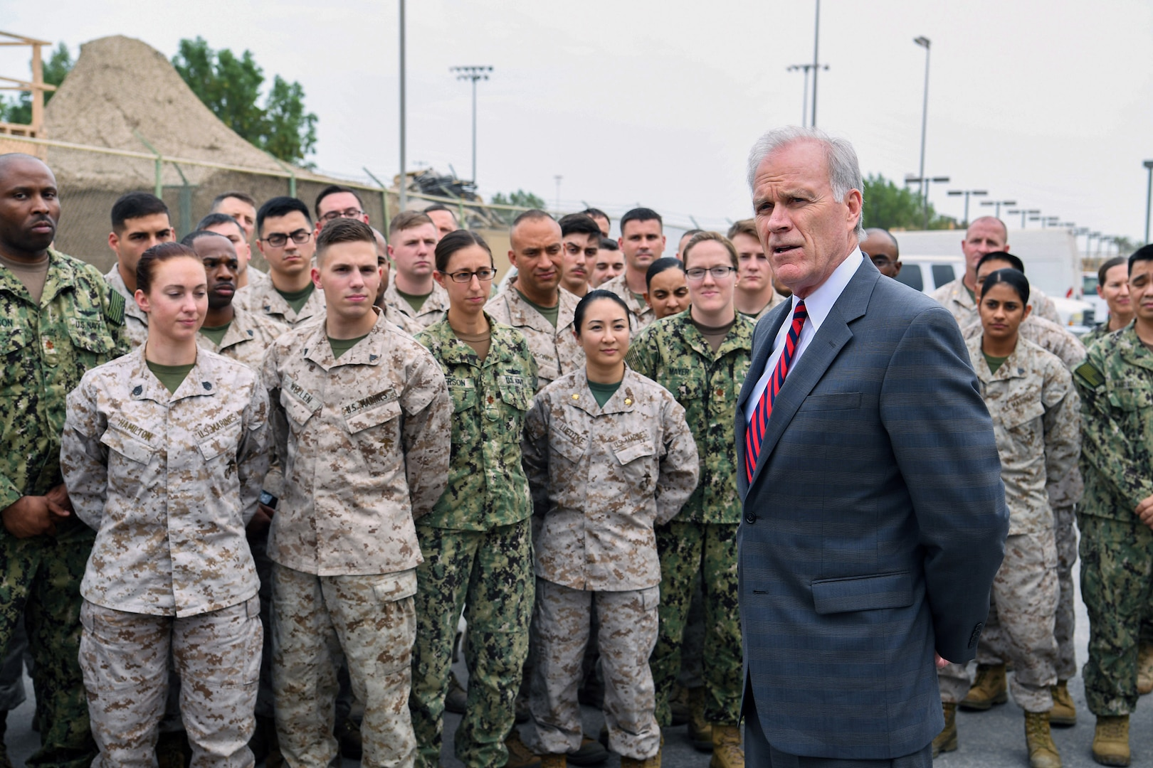 171122-N-GC639-0205 MANAMA, Bahrain (Nov. 22, 2017) Secretary of the Navy Richard V. Spencer speaks to Sailors and Marines as part of a visit to the 5th Fleet Area of Operations.  U.S. 5th Fleet conducts maritime operations to deter and counter regional threats, defeat violent extremism and strengthen partner nations' maritime capabilities in order to preserve the free flow of commerce and promote a secure maritime environment in the U.S. Central Command area of responsibility. (U.S. Navy photo by Mass Communication Specialist 2nd Class McLearnon/Released)