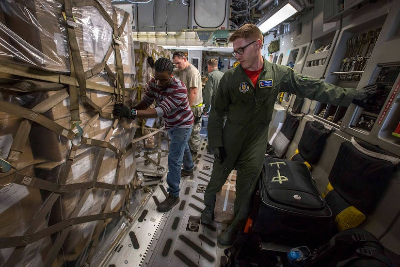 Air Force Staff Sgt. Adam D. Van Horn, C-17 Globemaster III loadmaster assigned to the 514th Air Mobility Wing's 732nd Airlift Squadron, locks a cargo pallet in place at Joint Base Charleston, S.C., Nov. 17, 2017. Air Force photo by Master Sgt. Mark C. Olsen