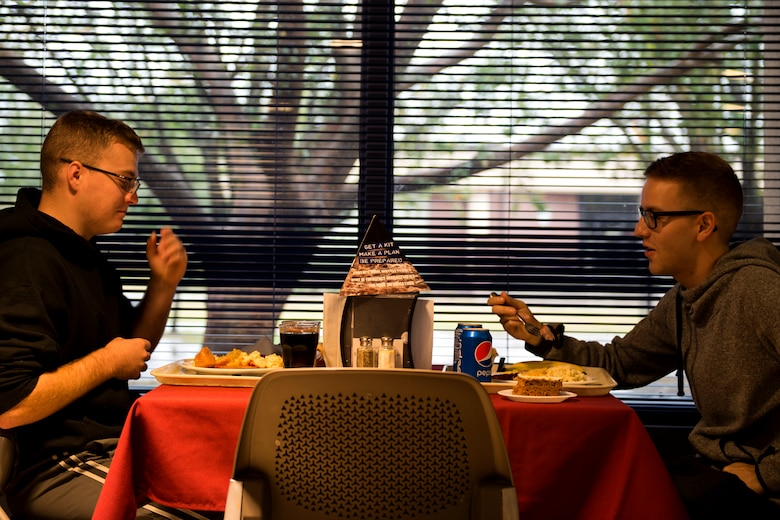Airman Brayden Olson, left, and Airman 1st Class Dalton Murphy, both 723d Aircraft Maintenance Squadron crew chiefs, eat together on Thanksgiving Day in the Georgia Pines Dining Facility, Nov. 23, 2017, at Moody Air Force Base, Ga. The Thanksgiving Day meal was an opportunity for Airmen, retirees, dependents and leadership to enjoy a traditional Thanksgiving meal. (U.S. Air Force photo by Airman 1st Class Erick Requadt)