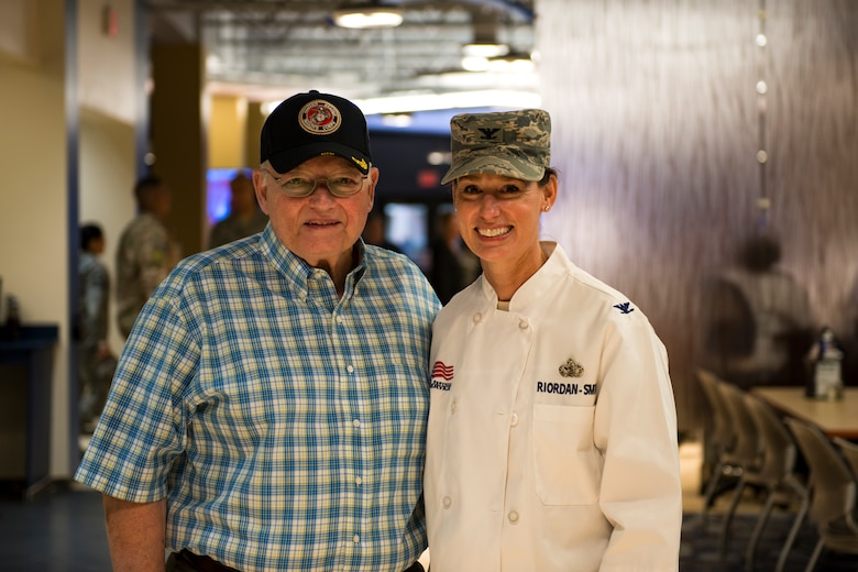 Retired U.S. Marine Lt. Col. Jim Riordan, left, and his daughter, Col. Susan Riordan-Smith, 23d Mission Support Group commander, pose for a photo on Thanksgiving Day in the Georgia Pines Dining Facility, Nov. 23, 2017, at Moody Air Force Base, Ga. The Thanksgiving Day meal was an opportunity for Airmen, retirees, dependents and leadership to enjoy a traditional Thanksgiving meal. (U.S. Air Force photo by Airman 1st Class Erick Requadt)