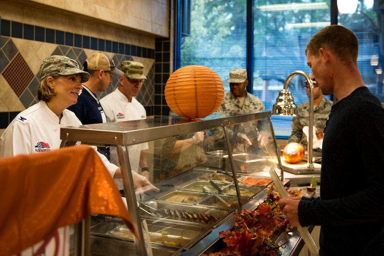 Col. Jennifer Short, 23d Wing commander, left, serves food to Airman 1st Class Tristan Batten, 23d Civil Engineer Squadron water and fuels system maintenance technician, on Thanksgiving Day in the Georgia Pines Dining Facility, Nov. 23, 2017, at Moody Air Force Base, Ga. The Thanksgiving Day meal was an opportunity for Airmen, retirees, dependents and leadership to enjoy a traditional Thanksgiving meal. (U.S. Air Force photo by Airman 1st Class Erick Requadt)