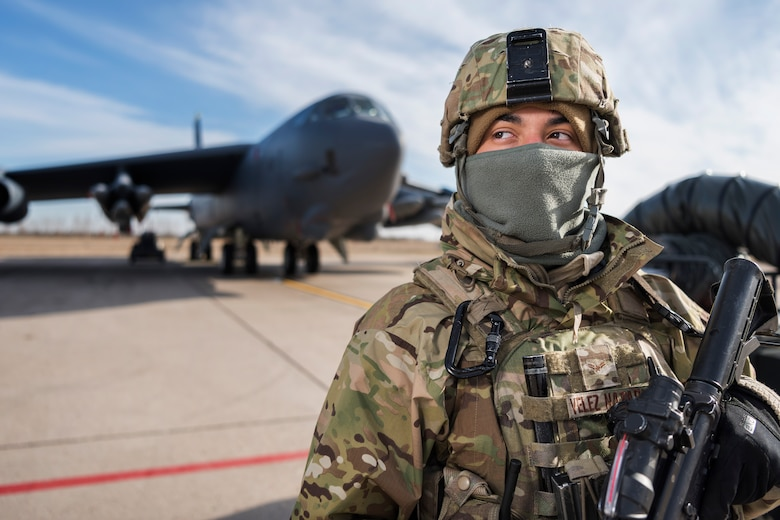 Airman 1st Class Reinaldo Velez-Nazario, 5th Security Forces Squadron defender, stands guard at Minot Air Force Base, N.D., Oct. 31, 2017, during Global Thunder 18. Exercise Global Thunder is an annual command and control and field training exercise designed to train Department of Defense forces and assess joint operational readiness across all of USSTRATCOM's mission areas, with a specific focus on nuclear readiness. (U.S. Air Force photo by Senior Airman J.T. Armstrong)