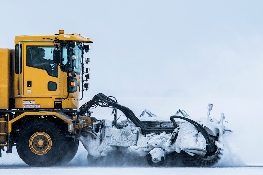 A snowplow clears the runway at Minot Air Force Base, N.D., Nov. 4, 2017, during exercise Global Thunder 18. Global Thunder is an annual command and control exercise designed to train U.S. Strategic Command forces and assess joint operational readiness. (U.S. Air Force photo by Senior Airman J.T. Armstrong)
