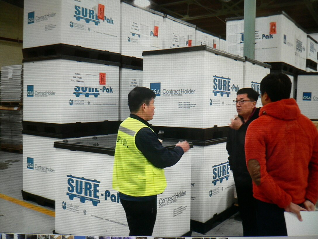 Yong Sik Pak (center) from DLA Disposition Services engages with customers at Camp Carroll on documentation and turn in procedures for the 1,400 line items of pre-positioned stock soon to be turned in at Gimcheon, South Korea.