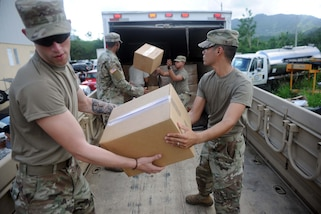 Soldiers and Federal Emergency Management Agency workers deliver food, water and supplies to residents of Villalba, Puerto Rico, Nov. 25, 2017. Working in coordination with local government officials, FEMA workers delivered more than 200 boxes of food and 300 cases of water to residents of the Caonillas Abajo neighborhood. Army photo by Steven Shepard