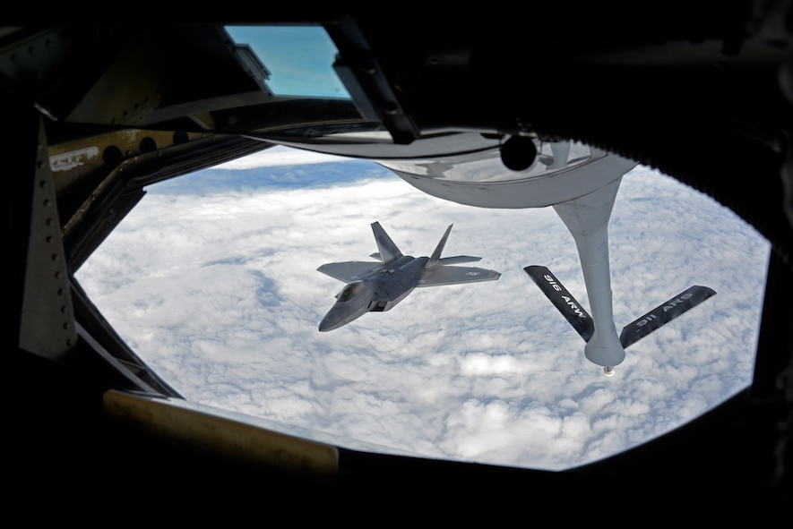 A KC-135 Stratotanker from Seymour Johnson Air Force Base, N.C. refuels an F-22A Raptor from the 95th Fighter Squadron, Tyndall Air Force Base, Florida, over European skies before landing at Mihail Kogalniceanu Air Base, Romania, April 25, 2016. The aircraft will conduct air training with other Europe-based aircraft to maximize training opportunities while demonstrating the U.S. commitment to NATO allies and the security of Europe. (U.S. Air Force photo by Capt. Leah Davis/Released)