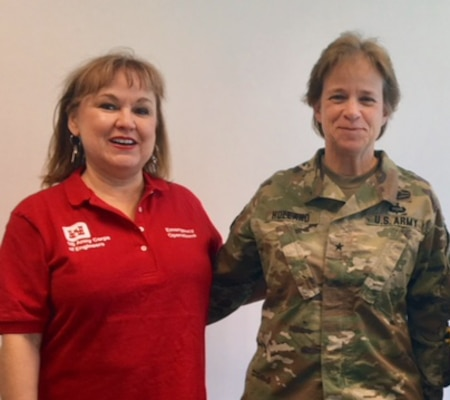 Cherryl Weeks poses with Division Commander Maj. Gen. Diana Holland while on deployment in Puerto Rico
