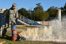 U.S. Air Force Tech. Sgt. Larry Diaz, 20th Civil Engineer Squadron noncommissioned officer in charge of training, opens a fire hydrant at Shaw Air Force Base, South Carolina, Nov. 17, 2017.