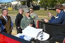 Fuel spill major accident response exercise participants discuss the simulated scenario at Shaw Air Force Base, South Carolina, Nov. 17, 2017.