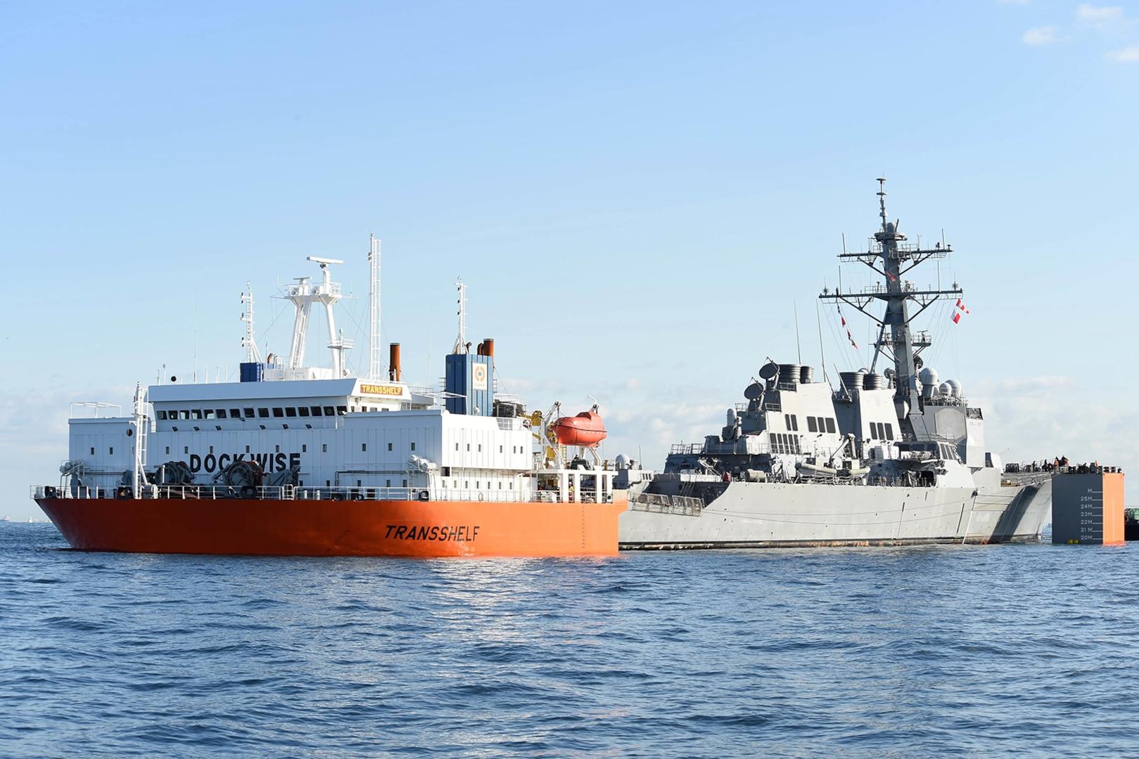 USS Fitzgerald Returns to Fleet Activities Yokosuka aboard MV Transshelf