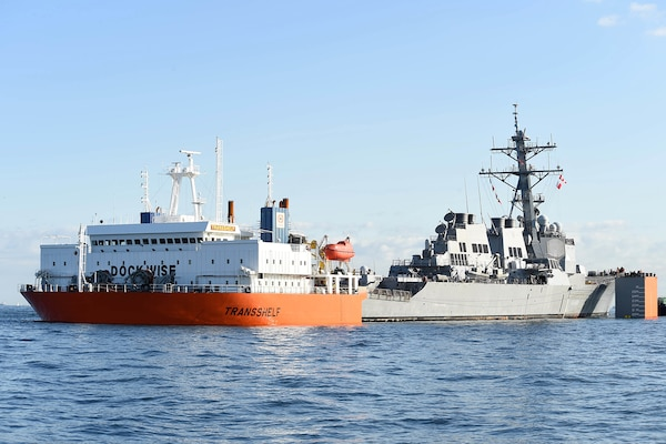 USS Fitzgerald Returns to Fleet Activities Yokosuka aboard MV Transshelf