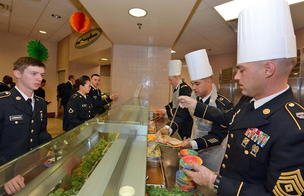 Maj. Gen. Brian C. Lein, Commanding General, Army Medical Department Center & School at Joint Base San Antonio-Fort Sam Houston, AMEDDC&S Command Sgt. Maj. Buck O'Neal and other leaders serve Thanksgiving dinner to Soldiers at the Rocco Dining Facility at JBSA-Fort Sam Houston Nov. 23.