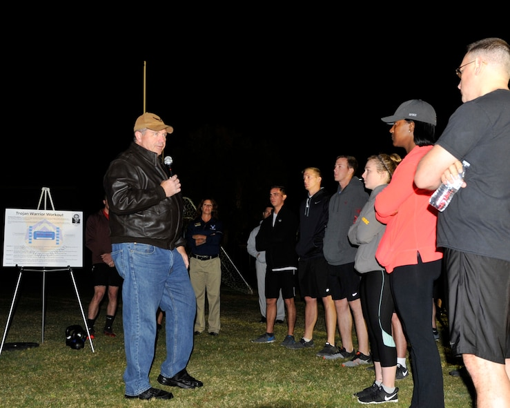 Retired Chief Master Sgt. Scott Dearduff addresses the Trojan Warrior Workout participants at Luke Air Force Base, Ariz., Nov. 27, 2017. Dearduff served with Maj. Troy gilbert before he died on Nov. 27, 2006. (U.S. Air Force photo/Airman 1st Class Pedro Mota)