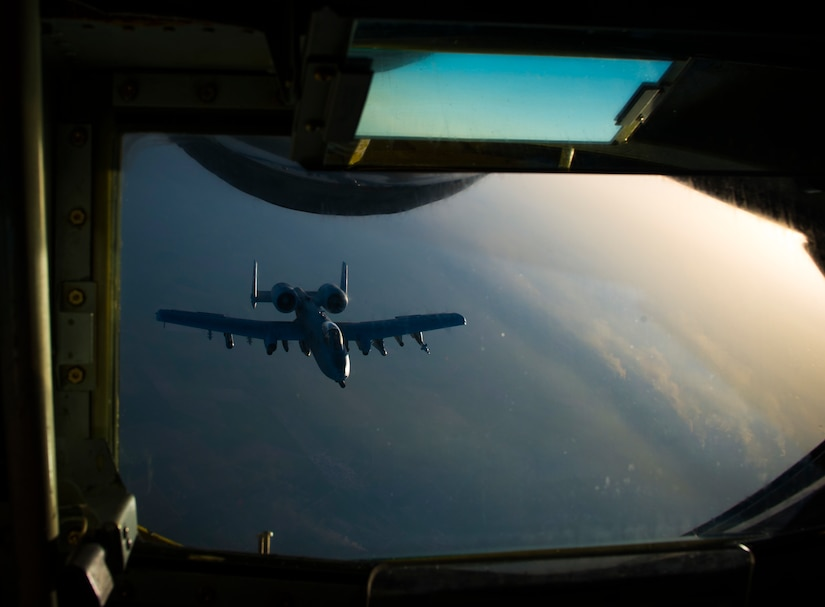 An Air Force A-10 Thunderbolt II departs after receiving fuel from a KC-135 Stratotanker