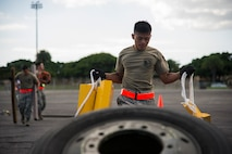 Airman 1st Class John Bonilla, 48th Aerial Port Squadron, moves equipment from one aircraft pallet to another during the combat fitness challenge portion of the Hickam Port Dawg Challenge, at Joint Base Pearl Harbor-Hickam, Hawaii, Nov. 17, 2017.