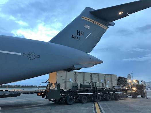 Cargo is offloaded out the back of a C-17 Globemaster III, San Juan International Airport, Oct. 8, 2017. The C-17 and crew were assigned to the Hawaii Air National Guard's 204th Airlift Squadron and were assisting with Hurricane Maria Relief efforts.