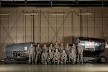 The last 374th Maintenance Squadron propulsion flight poses for a photo Nov. 17, 2017, at Yokota Air Base, Japan.