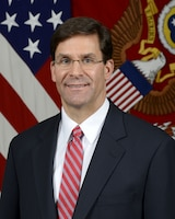 Dr. Mark T. Esper, Secretary of the Army, poses in front of the U.S. flag.