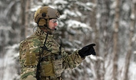 An Alaska Air National Guardsmen assigned to the 212th Rescue Squadron gives directions during a mass-casualty search-and-rescue training at Joint Base Elmendorf-Richardson, Alaska, Nov. 21, 2017. During the exercise, the rescue operators located, assessed, treated and evacuated numerous casualties while engaging and eliminating multiple attacks from opposition forces. In addition to training for combat search-and-rescue missions, the 212th Rescue Squadron also provides emergency rescue services for Alaska residents and visitors. (U.S. Air Force photo by Senior Airman Curt Beach)