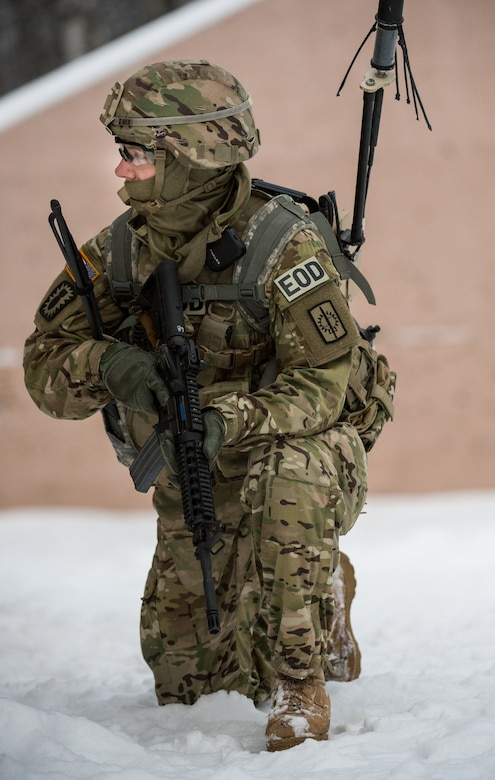 A Soldier assigned to the 716th Explosive Ordnance Disposal Company scans the area for threats after taking contact from opposition forces during a mass-casualty search-and-rescue training at Joint Base Elmendorf-Richardson, Alaska, Nov. 21, 2017. During the exercise, JBER Airmen and Soldiers located, assessed, treated and evacuated numerous casualties while engaging and eliminating multiple attacks from opposition forces. (U.S. Air Force photo by Senior Airman Curt Beach)