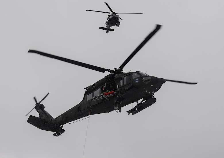 Alaska Army National Guard UH-60 Black Hawk helicopters arrive on scene during a mass-casualty search-and-rescue training at Joint Base Elmendorf-Richardson, Alaska, Nov. 21, 2017. During the exercise, the rescue operators located, assessed, treated and evacuated numerous casualties while engaging and eliminating multiple attacks from opposition forces. In addition to training for combat search-and-rescue missions, the 212th Rescue Squadron also provides emergency rescue services for Alaska residents and visitors. (U.S. Air Force photo by Senior Airman Curt Beach)