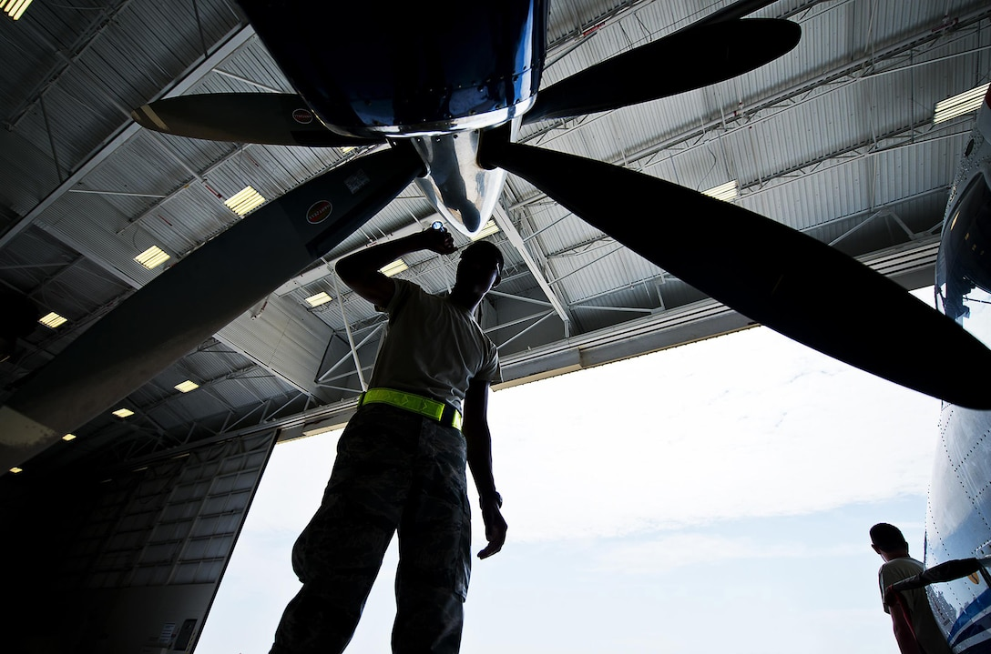 Airman Mario Hill, 919th Special Operations Maintenance Group, checks the intake of an engine on a C-145 at Duke Field, Florida. (Tech. Sgt. Sam King)