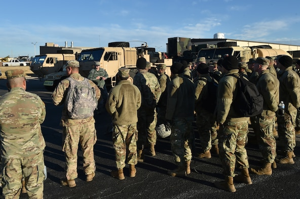 U.S. Air Force Master Sgt. Tracy Tinsley, the superintendent of air freight assigned to the 97th Logistics Readiness Squadron, talks to U.S. Army Soldiers assigned to the 4th Battalion, 3rd Air Defense Artillery Regiment about the plans for a joint exercise,