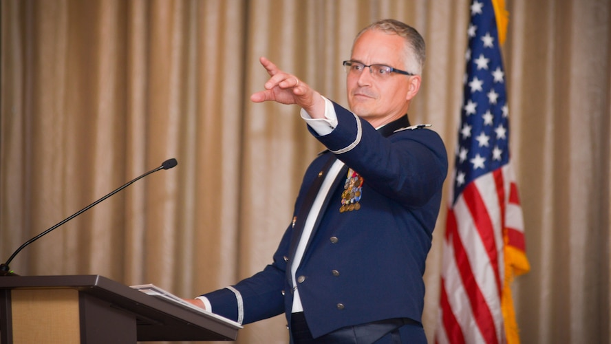 Retired Col. Michael Harasimowicz deliver his speech during the 91st Cyberspace Operations Squadron centennial celebration in San Antonio, Oct. 28, 2017. Members of the 91st COS gathered during a formal dining out event to celebrate the squadron's anniversary, and enjoy fine food and company. (Courtesy photo)