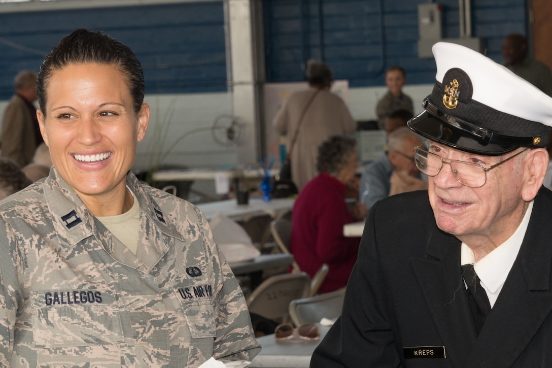 Captain Andrea Gallegos, with the Jeanne M. Holm Center for Officer Accessions and Citizen Development, shares a laugh with a veteran at last year's Military Retiree Appreciation Day event on Maxwell. This year's RAD is scheduled for Dec. 7, 10 a.m-2 p.m. at the Maxwell Honor Guard Hangar. (US Air Force photo by Trey Ward)