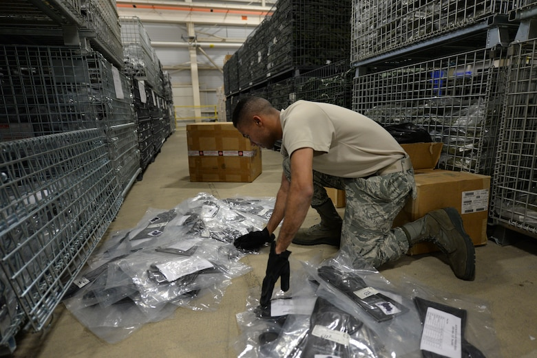Airman David Koyejo, 436th Logistics Readiness Squadron materiel management technician, counts gloves during a Civil Reserve Air Fleet readiness exercise Nov. 13, 2017, inside the individual protective equipment warehouse on Dover Air Force Base, Del. The exercise called for almost 1,250 full sets of IPE to be packed and shipped to two separate locations. (U.S. Air Force photo by Staff Sgt. Aaron J. Jenne)