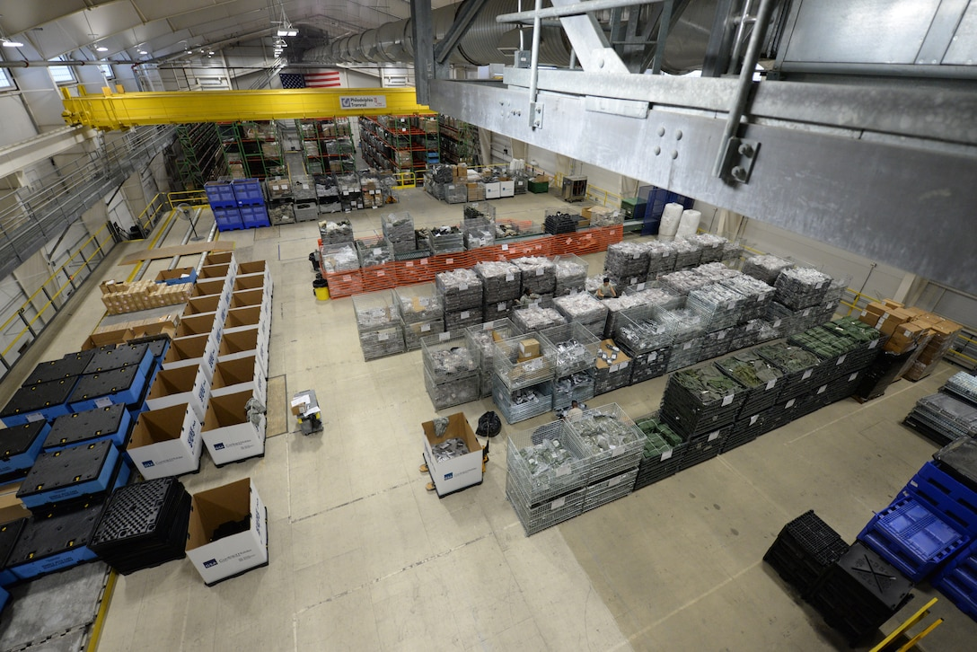 Members of the 436th Logistics Readiness Squadron individual protective equipment shop prepare chemical, biological, radiological and nuclear protective gear for a Civil Reserve Air Fleet readiness exercise Nov. 13, 2017, at Dover Air Force Base, Del. The 436th LRS is the only CRAF IPE repository in the DOD. (U.S. Air Force photo by Staff Sgt. Aaron J. Jenne)