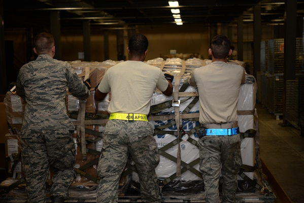 Members of the 436th Aerial Port Squadron move a pallet of individual protective equipment during a Civil Reserve Air Fleet readiness exercise Nov. 13, 2017, at Dover Air Force Base, Del. Members of the 436th LRS worked hand-in-hand with members of the 436th APS to prepare the IPE for flight. (U.S. Air Force photo by Staff Sgt. Aaron J. Jenne)
