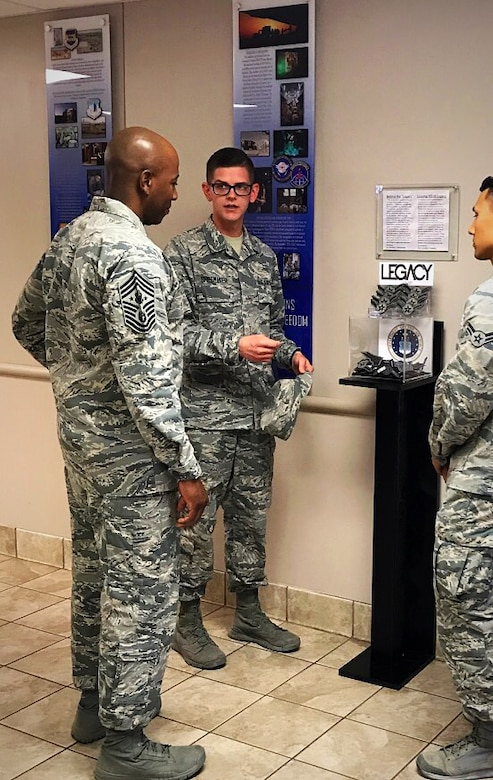 Chief Master Sgt. of the Air Force Kaleth O. Wright meets with Airman 1st Class Michael Shoemaker and Airman 1st Class Anthony Robbins, founder and cofounder of the Legacy Stripes Program, Aug. 4, 2017, at Joint Base San Antonio-Fort Sam Houston, Texas. To honor the legacy that service members create, Shoemaker and Robbins while still in technical training, saw an opportunity to encourage the donation of more than 1,000 sought-after stripes within a six-month period.