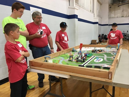STEM students, parents and NSWC Crane volunteer coaches participated and volunteered at a FIRST Lego League (FLL) competition on Nov. 18 at the Lawrence County Boys and Girls Club as 130 students competed for a chance to move on to the State Tournament scheduled for Dec. 2 at the University of Southern Indiana.