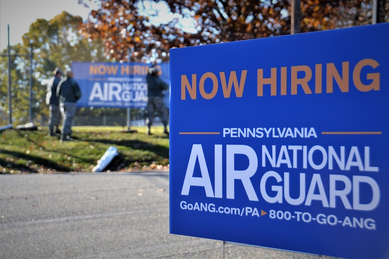 Members of the 111th Attack Wing Strength Management Team place signs outside of Horsham Air Guard Station, Pa., Nov. 24, 2017. The signs were situated during the kick off of their newest recruiting program, Operation Alma Mater. (U.S. Air National Guard photo by Tech. Sgt. Andria Allmond)